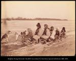 Image of Group of Goldes women and children on dog sled
