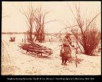 Image of Golde woman gathering firewood